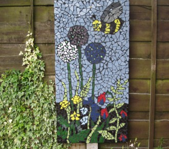 mosaic on fence